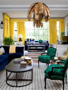 This combo is so chic: yellow curtains, sapphire sofa and emerald chairs!