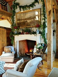A simple fir garland and arrangements of fir sprigs and red berries adorn the fireplace in this Virginia country home.