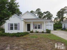 145 Tylers Cove Way, Winnabow, NC 28479. 3 bed, 2 bath, $110,000. What a Terrific Home...