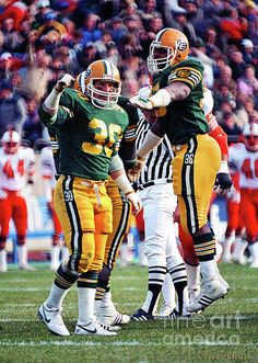 Reaction photograph of Edmonton Eskimos linebackers Danny Bass #30 and jumping up for joy Stewart Hill #36 after a quarterback sack against the B.C. Lions in a 1985 game in Edmonton.