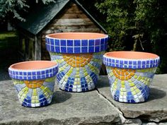I love these mosaic flower pots