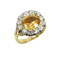 Georgian yellow topaz and diamond cluster ring, the cushion shaped topaz bordered by diamonds, close set in silver and gold, later engraved to verso. 1920s Jewelry, Antique Jewelry, Vintage Jewelry, Jewelry Accessories, Imperial Topaz, Diamond Cluster Ring, Vintage Rings, Gold Glitter, Birthstones
