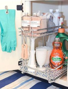 How To Organize Under The Kitchen Sink - fabulous ideas for tackling that hard to organize space! Kitchen organization, how to organize kitchen cabinets, under the sink, dollar store organizing ideas, organize cleaning products, reduce clutter #organizingclutter