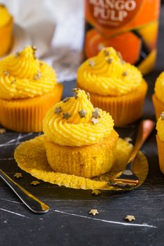 These soft Mango Cupcakes are filled with crushed pineapple and topped with a light and fluffy mango frosting. A delicious tropical cupcake perfect for the warmer weather! Are you excited for the R… Mango Cupcakes, Strawberry Cheesecake Cupcakes, Savory Cupcakes, Pineapple Cupcakes, Pumpkin Pie Cupcakes, Healthy Cupcakes, Cupcake Flavors, Banana Oat Muffins, Apple Cinnamon Muffins
