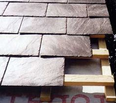 Lightweight, easy to handle slate-looking tiles made from recycled car tyres and recycled plastic.