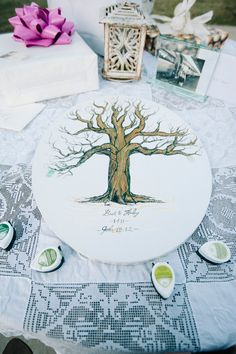illustrated tree guest book, photo by Sarah Beth Photography http://ruffledblog.com/intimate-louisiana-wedding #guestbooks #wedding #reception
