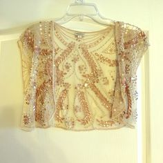 beaded shrug, pale pink and pearls adorable shrug from Anthropologie that can be worn over any sleeveless dress or pair with a tank and jeans! Anthropologie Tops