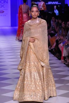 Anita Dongre Featuring an exquisite cream raw silk lehenga, fully embroidered paired with a gold embroidered sheer net choli with an underlayer of gold raw silk bustier. Indian Bridal Lehenga, Indian Sarees, Ethnic Fashion, Indian Fashion, Modern Fashion, Women's Fashion, Indian Attire, Indian Wear, Indian Dresses
