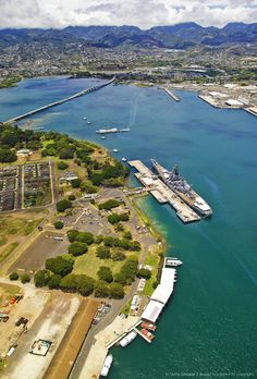 Hawaii, Oahu, Pearl Harbor, Aerial view of the USS Arizona Memorial and USS Missouri, WWII battelships.