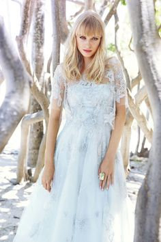 Soft blue is a beautiful choice for the unconventional bride. Pair this playful gown with a matching, sheer embellished top for real wow factor.