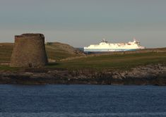 One of the Northlink ferries sailing out of Shetland past the island of Mousa