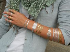 Ocean Jewelry, Temporary Metallic Tattoos by ShimmerTatts: EXPRESS yourself with our ORIGINAL silver and gold jewelry temporary tattoo designs by artist, Melissa Drake, the absolute hottest new way to add a sparkly lustrous flair to your fashion accessories! Non-toxic, WATERPROOF, and ideal for every event- beach, poolside, parties, clubs, festivals, boating, concerts, yoga, dinner dates, or even Sunday brunch. Youre sure to turn heads in our stunning shiny ShimmerTatts. Perfect jewelry to…