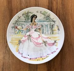 Cinderella slips onto this plate. Her motif is unmistakable. See you all at the boutique before your own footmen turn to mice. We are full of enchantment, no matter what the hour. #TwigsofNWH #Cinderella #Enchantment #Plate #ThriftforPhilanthropy #NorthernWestchesterHospital