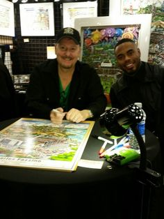 Charles Fazzino appeared at the NFL Shop with Rashad Jennings of the NY Giants and founder of The Locker Room project. Fazzino's 3D pop art work created just for the foundation appears behind the two. (Feb 2016)