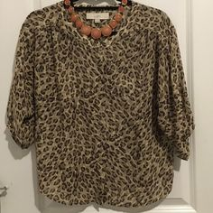 Cheetah print blouse Ann Taylor Loft Cheetah print blouse XS petite. Great with jeans or dressed up for work. In good condition, worn a few times!  LOFT Tops Blouses