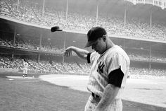In one of the most poignant pictures ever made of a great athlete in decline, 33-year-old Mickey Mantle — his electrifying talents blunted by injuries, age and years of alcohol abuse — tosses his helmet away in disgust after a weak at-bat at Yankee Stadium, June 1965.  John Dominis