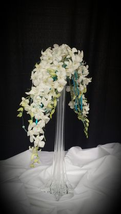 Balanced arm bouquet of white dendrobium orchids #gouldsflowers #716433ROSE #gouldsflowers&gifts www.gouldsflowers.com