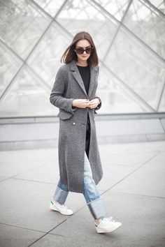 A grey maxi coat such as this will always add a touch of sophistication and glamour to your every day outfit. Nika Huk wears this Zara piece over rolled jeans and a pair of Adidas Stan Smiths. Coat:...