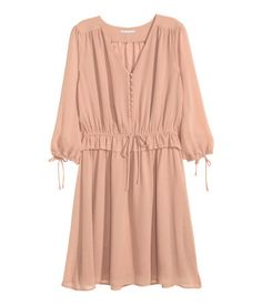 Powder beige. Knee-length dress in chiffon with a V-neck, covered buttons at the top, 3/4-length sleeves with elastication and ties at the cuffs.  Sale for R499