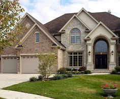If your home has a wood exterior, use wood garage doors and paint them the same color as your siding so they're less conspicuous