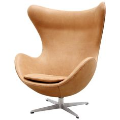 Cognac Leather Egg Chair by Arne Jacobsen for Fritz Hansen, 1966 | From a unique collection of antique and modern lounge chairs at https://www.1stdibs.com/furniture/seating/lounge-chairs/