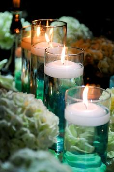 To add some extra color to the tables,  tint the water in the floating candle vases.