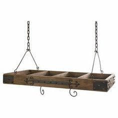 Crafted from wood with iron hardware, this rustic hanging pot rack stylishly stows your kitchen essentials. Product: Hanging pot rackConstruction Material: Wood and ironColor: BrownDimensions: H x W x D (including chains) Pot Rack Hanging, Hanging Pots, Rustic Pot Racks, Rustic Wood, Rustic Decor, Home Goods Decor, Home Decor, Kitchen Essentials, Diy Kitchen