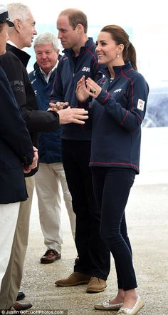 Excited: Kate looks thrilled as she arrives at the Royal Naval base and chats to waiting c...