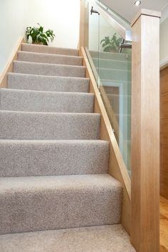 Oak Newels and Structural Glass Infill for Feature Staircase - house and flat decorations Carpet Staircase, House Staircase, Staircase Design, Staircase Ideas, Bannister Ideas, Hallway Carpet, Wall Carpet, Oak Stairs, Glass Stairs