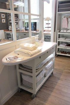 Love this. IKEA hack - cart topped with ironing board. Awesome for laundry room.