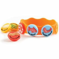 These bright, stretchy bracelets are a great way to alert others about your child's food allergies. To insert charms, simply stretch the wristband a little with one hand, and elongate a hole. Then squeeze the charm backing and insert it partially into the hole and pull the backing through the other side - a bit like threading a needle. Do not use a sharp object to elongate the hole. Continue until you have installed all of the charms your child needs. What a great idea.