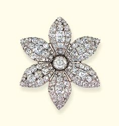 A FINE GEORGE III DIAMOND FLOWER BROOCH  Designed as a clematis, the six old-cut pavé-set diamond petals to the diamond collet centre, mounted in silver, in closed back setting, circa 1770, 6.5 cm. wide, later brooch fitting, in blue velvet fitted case