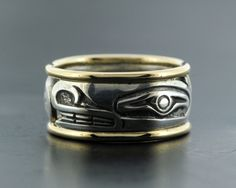 Norman Bentley  ---   Silver Ring with 14k Rails ---   Mr. Bentley had the privilege of completing an apprenticeship with the great Bill Reid, perhaps the best known artist from British Columbia, if not Canada.