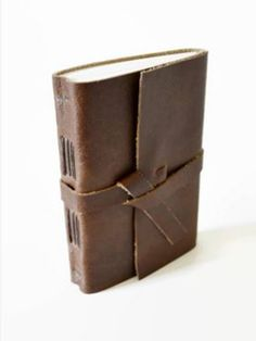 Reminiscent of medieval manuscript books, this journal is made of buttery soft genuine chocolate brown leather that is soft, flexible, and durable. It features a self-leather wrap tie to keep your tre