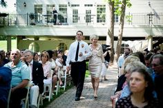 An Orange & Purple Wedding: The Mother of the Bride is escorted down the aisle by her son. http://linnealizphotography.com