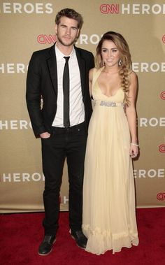 Liam Hemsworth And Miley Cyrus Red Carpet- what happened to miley?! she use to be so pretty!