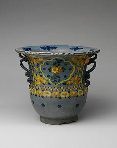 1) Tin-glazed earthenware flower pot ( Mexico, circa 1830).2)...