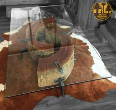 """Nativo Red Wood. Mesa de centro linea """"Natural Wood"""" con troncos reciclados de una pieza de Roble Rústico con corteza con soportes originales de fierro forjado y cubierta de cristal de 0.90x1.40x15 mm espesor. Cuero natural de vacuno cafe con blanco. Disponibles en nuestra sucursal de Barrio Italia, en Av. Italia 1334, local 2, Galeria Casa Mestiza, Providencia. +56962277920 www.facebook.com/nativoredwoodsa"""