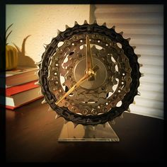 bring your passion to work with a Bike Gear Desk Clock. made from recycled bicycle parts, it comes on an elegant acrylic stand making it a lovely cyclist gift or a wonderful desk clock for you.  Dream Great Dreams saving the planet one clock at a time.