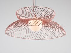 An edgy dining room light in dusty pink