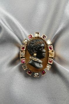ANTIQUE BLACKAMOOR CAMEO, THE HARDSTONE CAMEO WITH FIGURE IN PROFILE WEARING AN OLD MINE-CUT DIAMOND COLLAR AND GOLD BEAD EARRING