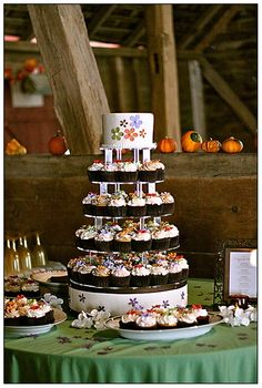 Fall themed cupcake tower - love the flowers #wedding #weddingcupcakes #cupcaketower #fall #weddingdessert