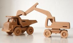 As a toy designer and wood lover, I designed different vehicles and produced them with a specially developed method. All the models are made from beech wood and used no metal parts, only wood, glue and water based varnishing.