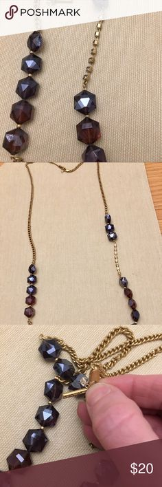 Kenneth Brass tone Purplish Blueish Bead Accents Kenneth Cole Brass tone Necklace Purplish Blueish Iridescent Large Bead Accents. Never been worn Kenneth Cole Jewelry Necklaces