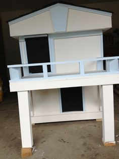 2 story dog house with inside stairs and upstairs balcony