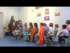 waldorf school's channel of videos showing how they teach english(2nd language) by playing,poems movement etc. another http://www.youtube.com/watch?v=2f6n4HU-R4U=channel=UL  http://www.youtube.com/watch?feature=player_embedded=vcigUyDCrig
