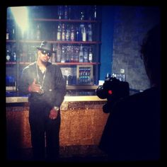"""With Kelvin on the way, Kutt Calhoun gets the VIP treatment on the set of the """"Bottle Service"""" music video.    Shot inside the Aura nightclub in Kansas City, the brand new music video from Kelvin had the bottles and KC crowd out in celebration as Ubiquitous of CES Cru, BG Bulletwound, Bryan B. Shynin, DJ Kittie, and JL of B. Hood stopped in to join the Kansas City Chief on set.    You'll have to wait for the visual, but for now click to check out the behind the scenes flicks!"""