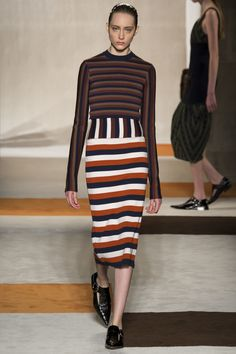 Victoria Beckham changes into stripe midi-dress after New York Fashion Week show | Daily Mail Online