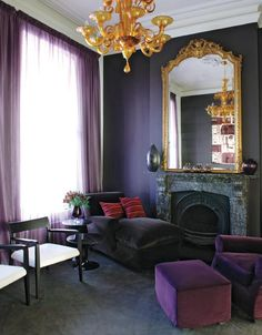 living room: plum, gold, chandelier, gilded mirror