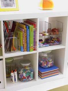 Home Office - Tip #3  If you've made kids a part of your home office, says Loecke, allocate an area for their stuff. Organize small items like art supplies in transparent bins and containers so there's no confusion about where things go.